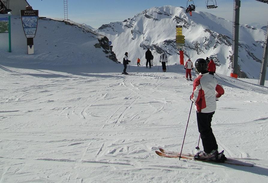 PORTES DU SOLEIL, FRANCE - FEB 12 - Skiers prepare for their next run on Feb 12, 2011, near Chatel, France
