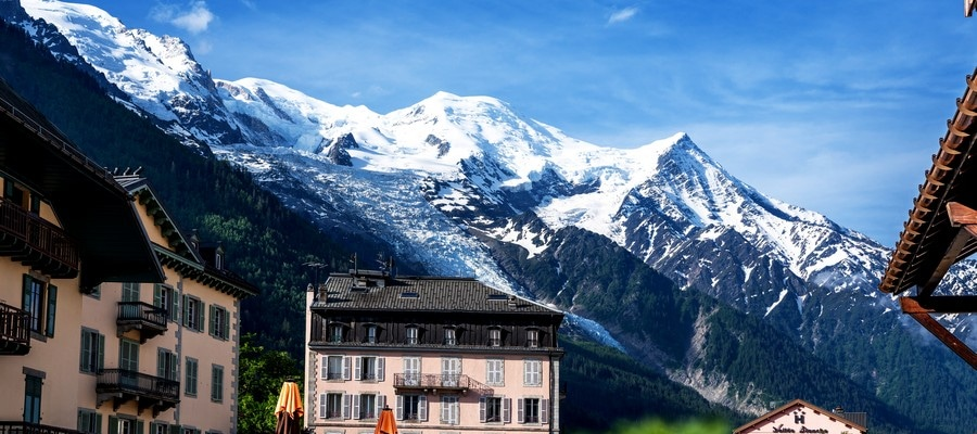 Amazing scenery of the Alps from Chamonix France. Chamonix downtown in summer. Beautiful buildings on a sunny day of summer. Flowers, colorful facades.