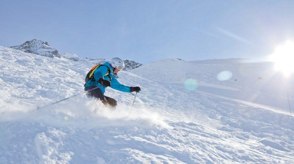 Viewing a Ski Chalet: Skier
